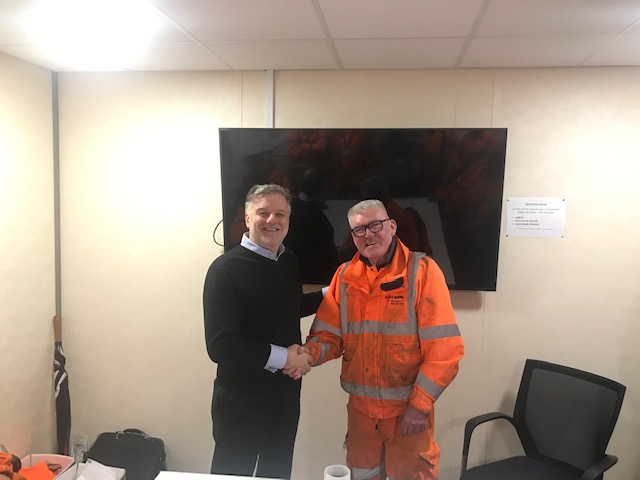 "Lowery's Managing Director presented Dave Revie with a small gift in recognition of him receiving 'Making a Difference Award"" from Skanska"